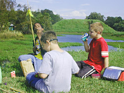 three boys enjoying a picnic lunch at Moundville