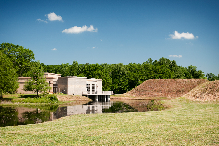 View of the mounds, lake, and museum
