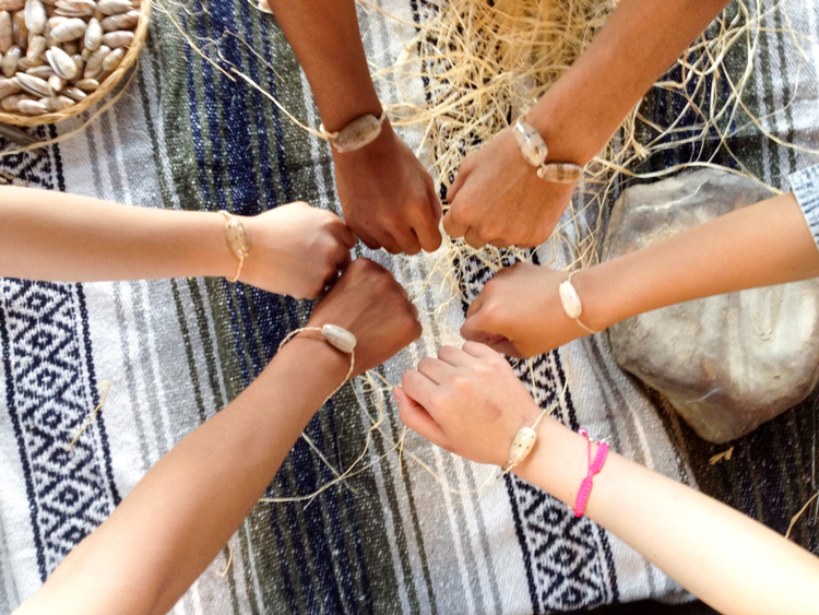 children showing off their friendship bracelets